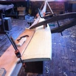 First piece of a garboard being fitted to the keel, with its scarf marked, but not yet cut.